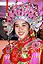 Girl wearing traditional dress at Mooncake Festival in Kuching